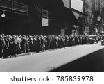 Small photo of New York men in a bread line during the Great Depression, 1935-38. The sign read, 'Paid Up to this Point, Every Dollar pays for 20 More Meals. Men ahead of the sign are assured of a five-cent meal--th