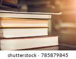 stack of books on wooden table... | Shutterstock . vector #785879845