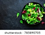 mix salad leaves in a black... | Shutterstock . vector #785890705
