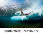 young surfer dives under the... | Shutterstock . vector #785902672