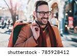 man in shopping. smiling man... | Shutterstock . vector #785928412
