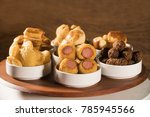 mixed brazilian snack on the... | Shutterstock . vector #785945566