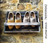 Wooden Clogs Hang On The Wall