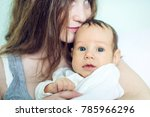 happy caring mother holding... | Shutterstock . vector #785966296