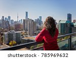 girl on high rise balcony with... | Shutterstock . vector #785969632
