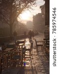 Small photo of GRANADA, ANDALUCIA, SPAIN - DECEMBER 20, 2017: Outdoor cafe chairs in Bar Fontana on the Carrera del Darro in afternoon sunhaze on December 20, 2017 in Granada, Andalucia, Spain