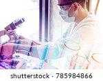 double exposure of scientist or ... | Shutterstock . vector #785984866
