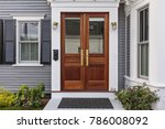 Small photo of Front door, double brown front door with a secured front entrance