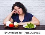 young upset overweight woman... | Shutterstock . vector #786008488