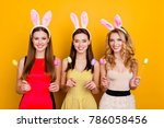 happy easter  three pretty ... | Shutterstock . vector #786058456