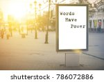 Small photo of words have power - words, phrase. on a white background billboard in the center of the city against sun rays