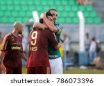 Small photo of President Prudente, Brazil, November 11, 2011. Players Fred and Barcos embrace each other before starting the game Fluminense vs. Palmeiras for the Brazilian football championship in Prudentão stadiu.