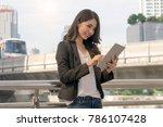 portrait business woman using... | Shutterstock . vector #786107428
