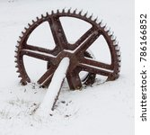 old rusty wheel in the snow | Shutterstock . vector #786166852