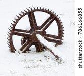 old rusty wheel in the snow | Shutterstock . vector #786166855