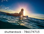 a surfer girl on water surface... | Shutterstock . vector #786174715