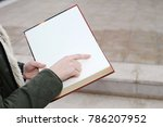 a girl with a book in her hand | Shutterstock . vector #786207952