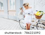 beautiful  blond woman riding a ... | Shutterstock . vector #786221092