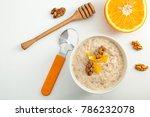 millet porridge with orange and ... | Shutterstock . vector #786232078