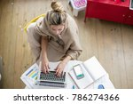 young beautiful woman works on... | Shutterstock . vector #786274366
