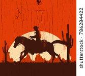 Silhouette Of Cowboy On Runnin...
