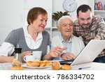 smiling grandparents and... | Shutterstock . vector #786334702