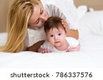 adorable baby girl in white... | Shutterstock . vector #786337576
