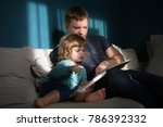 father reading a story to his...   Shutterstock . vector #786392332
