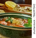 Small photo of Arabian cuisine - Shurba Omani, Omani Vegetable Soup, Traditional assorted dishes, Top view.