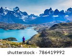 Small photo of Woman at mirador Condor enjoying hiking and top view of mountains Los Cuernos and turquoise lake Pehoe in Torres del Paine National park, Patagonia, Chile