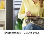 young woman sitting on sofa in... | Shutterstock . vector #786451966