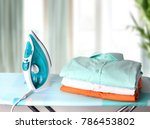 stack clothes on ironing board... | Shutterstock . vector #786453802