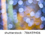 Small photo of Abstract of Bright and sparkling bokeh background. silver and golden bokeh from light burb.
