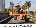 male control boom lift in a... | Shutterstock . vector #786463882