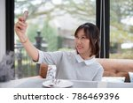 woman sitting at dining table...   Shutterstock . vector #786469396