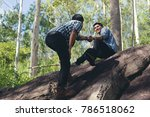 A Hiker Is Pulling His Friend\'...