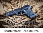 Small photo of Georgetown, Texas / USA - January 3 2018: Ruger P85 Handgun with 9mm Ammunition displayed on a webbed brown and black background.