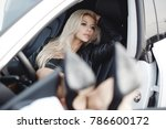 sexy young blonde woman in car. ... | Shutterstock . vector #786600172
