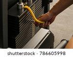 male hand choosing a weight on... | Shutterstock . vector #786605998