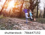 couple jogging and running... | Shutterstock . vector #786647152
