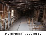 a long narrow hallway of bare... | Shutterstock . vector #786648562