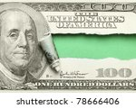 torn hundred dollar bill with...