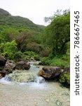 Small photo of Lush green mountain landscape and waterfall, water stream in Ayn Khor tourist resort, Salalah, Oman