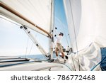 man lifting the sale of yacht... | Shutterstock . vector #786772468