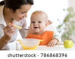 mother feeding her baby son... | Shutterstock . vector #786868396