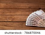 one hundred baht bills on the... | Shutterstock . vector #786870046