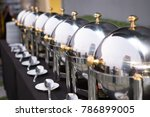 chafing dishes on the table at... | Shutterstock . vector #786899005