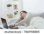 men with laptop at home | Shutterstock . vector #786958885