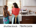 mum and daughter washing hands... | Shutterstock . vector #786961606