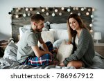 cheerful couple talking in bed   | Shutterstock . vector #786967912
